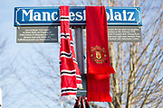 Manchester United scarf on road sign during the ceremony at Manchesterplatz, Munich, Germany. Picture by Phil Duncan.