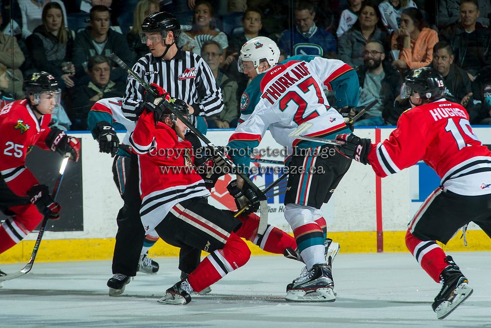 KELOWNA, CANADA - APRIL 7: Calvin Thurkauf #27 of the Kelowna Rockets checks a player of the Portland Winterhawks after the face off on April 7, 2017 at Prospera Place in Kelowna, British Columbia, Canada.  (Photo by Marissa Baecker/Shoot the Breeze)  *** Local Caption ***