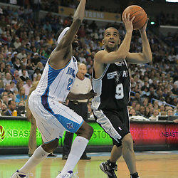 29 March 2009:  San Antonio Spurs guard Tony Parker (9) drives past New Orleans Hornets forward Julian Wright (32) during a 90-86 victory by the New Orleans Hornets over Southwestern Division rivals the San Antonio Spurs at the New Orleans Arena in New Orleans, Louisiana.