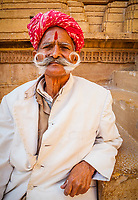 Portrait of a man with a large mustache and wearing a turban  in Jaisalmer, Rajasthan, India.