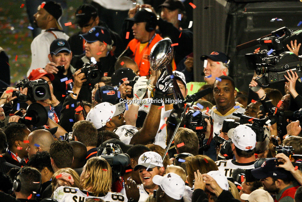 2010 February 07: New Orleans Saints players celebrate on the field with the Vince Lombardi Trophy following a 31-17 win by the New Orleans Saints over the Indianapolis Colts in Super Bowl XLIV at Sun Life Stadium in Miami, Florida.