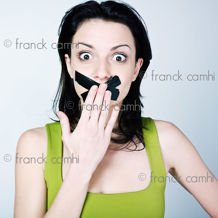 portrait of young woman reduce to silence on isolated background