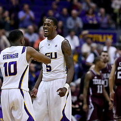 Jan 23, 2013; Baton Rouge, LA, USA; LSU Tigers forward Shavon Coleman (5) and guard Andre Stringer (10) celebrate during the second half of win over the Texas A&M Aggies at the Pete Maravich Assembly Center. LSU defeated Texas A&M 58-54. Mandatory Credit: Derick E. Hingle-USA TODAY Sports