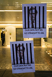 © Licensed to London News Pictures. 20/03/2018. London, UK. Posters which depicts Cambridge Analytica CEO Alexander Nix behind bars attached to the window of the office building which houses the company's offices in central London. Cambridge Analytica has been implicated in an investigation in to the misuse of Facebook user data to influence the outcome of elections. Photo credit: Rob Pinney/LNP