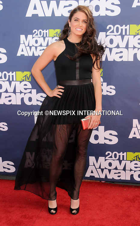 """NIKKI REED.attends the 2011 MTV Movie Awards at the Gibson Amphitheatre on June 5, 2011 in Universal City, California.Mandatory Photo Credit: ©Crosby/Newspix International. .**ALL FEES PAYABLE TO: """"NEWSPIX INTERNATIONAL""""**..PHOTO CREDIT MANDATORY!!: NEWSPIX INTERNATIONAL(Failure to credit will incur a surcharge of 100% of reproduction fees)..IMMEDIATE CONFIRMATION OF USAGE REQUIRED:.Newspix International, 31 Chinnery Hill, Bishop's Stortford, ENGLAND CM23 3PS.Tel:+441279 324672  ; Fax: +441279656877.Mobile:  0777568 1153.e-mail: info@newspixinternational.co.uk"""