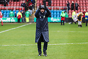 Forest Green Rovers assistant manager, Scott Lindsey applauds the fans during the EFL Sky Bet League 2 match between Crewe Alexandra and Forest Green Rovers at Alexandra Stadium, Crewe, England on 27 April 2019.