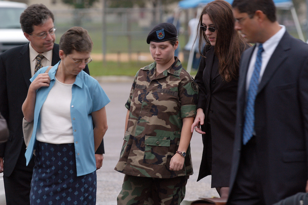 FORT BRAGG, NC - Pfc. Lynndie England arrives with her mother Terri England (Left, in blue and white) and her legal council at the Staff Judge Advocate Building on Fort Bragg in Fayetteville, NC on 8/3/04 for her Article 32 investigation hearing. England is charged with several counts, including one specification of conspiring to commit maltreatment of an Iraqi detainee, three specifications of assault against Iraqis, and several others.