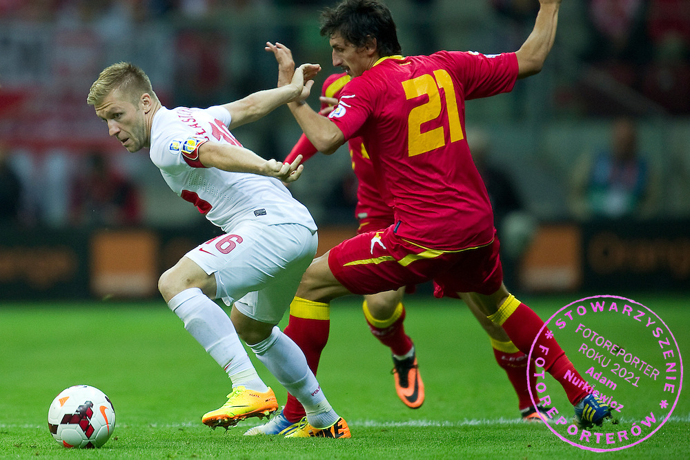 (L) Poland's Jakub Blaszczykowski fights for the ball with (R) Montenegro's Stefan Savic during the 2014 World Cup Qualifying Group H football match between Poland and Montenegro at National Stadium in Warsaw on September 06, 2013.<br /> <br /> Poland, Warsaw, September 06, 2013<br /> <br /> Picture also available in RAW (NEF) or TIFF format on special request.<br /> <br /> For editorial use only. Any commercial or promotional use requires permission.<br /> <br /> Mandatory credit:<br /> Photo by &copy; Adam Nurkiewicz / Mediasport