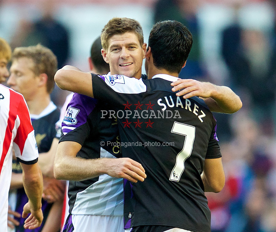 SUNDERLAND, ENGLAND - Sunday, September 29, 2013: Liverpool's captain Steven Gerrard embraces Luis Suarez after his side's 3-1 victory over Sunderland during the Premiership match at the Stadium of Light. (Pic by David Rawcliffe/Propaganda)