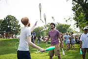 Benjamin Barlow, right, receives a juggling lesson during the Makeshift Festival at Tenney Park in Madison, Wisconsin, Sunday, Aug. 12, 2018.