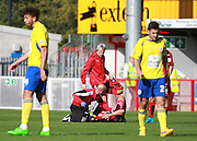 Crawley Town central defender Jon Ashton receives treatment for his injury during the Sky Bet League 2 match between Crawley Town and Accrington Stanley at the Checkatrade.com Stadium, Crawley, England on 26 September 2015. Photo by Bennett Dean.