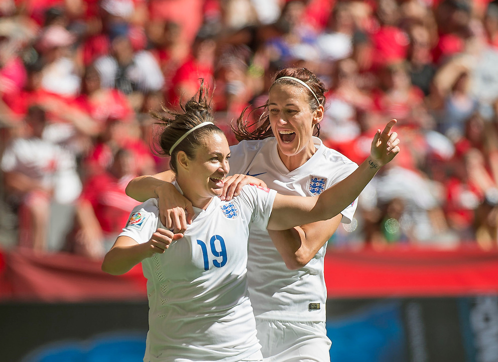 Jodie Taylor of team England celebrates England's first goal with team-mate Jill Scott of team England during 2015 women's World Cup Soccer in Vancouver during second round action between England and Canada.