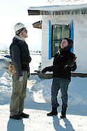 PRICE CHAMBERS / NEWS&amp;GUIDE<br /> Neighbors Jim Wolfgang and Felicia Aughenbaugh talk outside their home during a day of construction in January. Each of the Habitat for Humanity homes in the development are duplexes.