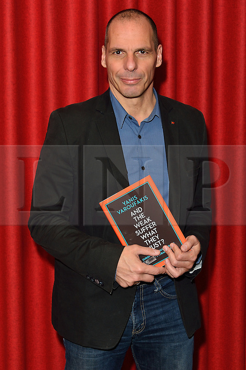 """© Licensed to London News Pictures. 05/04/2016. Former finance minister YANIS VAROUFAKIS signs copies his new book """"And The Weak Must Suffer What They Must?"""" at Foyles bookstore on a visit to the UK. London, UK. Photo credit: Ray Tang/LNP"""