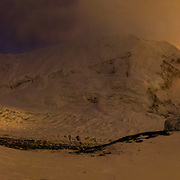 David Morton descends the West Ridge Headwall through ethereal light at sunset on Mount Everest, Nepal. Camp 2 and the Western Cwm lie below.<br />