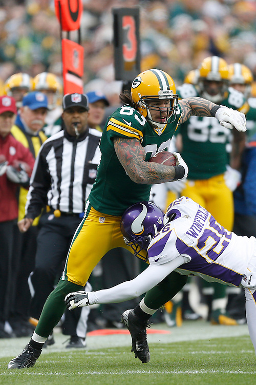 GREEN BAY, WI - DECEMBER 2:  Tom Crabtree #83 of the Green Bay Packers is tackled by Antoine Winfield #26 of the Minnesota Vikings at Lambeau Field on December 2, 2012 in Green Bay, Wisconsin.  The Packers defeated the Vikings 23-14.  (Photo by Wesley Hitt/Getty Images) *** Local Caption *** Tom Crabtree; Antoine Winfield