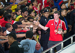 KUALA LUMPUR, MALAYSIA - Saturday, July 16, 2011: Liverpool's Jamie Carragher with a trophy after beating a Malaysia XI at the National Stadium Bukit Jalil in Kuala Lumpur on day six of the club's Asia Tour. (Photo by David Rawcliffe/Propaganda)