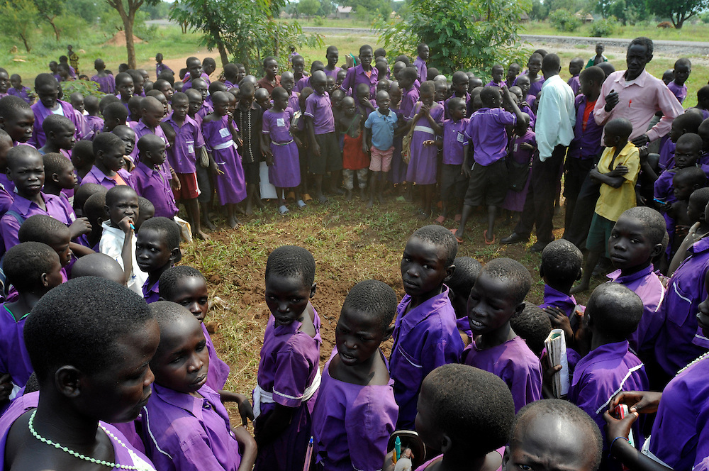 Students are evacuated to allow an EOD team from Mines Advisory Group (MAG) to destroy an unexploded ordinance found in the entrance to the Iriya Basic School..Iriya, South Sudan. 01/07/2011..Photo © J.B. Russell