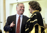 Democratic Presidential Candidate Howard Dean, left jokes with a member of the choir during mass at the Holy Redeemer Institutional Church of God in Christ on a campaign stop in Milwaukee WI Sunday Feb. 1, 2004..........