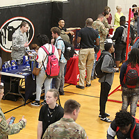 Shannon High School Seniors visit the different booths set up in the gym they look for jobs at the Shannon High School Job Fair Wednesday morning. Lee County Schools new career coaches, provided by the Toyota Wellspring Education Fund, have organized job fairs this school year where local businesses participate and give the students experience talking to the representatives about possible internships or employment.