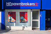 H&T pawnbrokers shop front on a high street in Hackney, London, United Kingdom.  A pawnbroker is an individual or business that offers secured loans to people, with items of personal property used as collateral.  If an item is pawned for a loan, within a certain contractual period of time the pawner may redeem it for the amount of the loan plus some agreed-upon amount for interest. The amount of time, and rate of interest, is governed by law or by the pawnbroker's policies.  Increasing numbers of people in Britain are using pawnbrokers to survive financial crises.