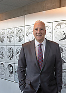 Garden City, New York, USA. June 21, 2018. Former NASA space shuttle astronaut MIKE MASSIMINO stands next to Long Island Air & Space Hall of Fame wall of plaques, during his induction into Class of 2018 at Cradle of Aviation Museum.