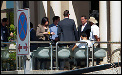Rebecca Blake and Conor McRedmond at Dubai Courts, Dubai, UAE, February 5, 2013. Photo by Logan Fish / i-Images..Rebecca Blake distinguishing clothing: Tan jacket, black sunglasses, straight black hair.Conor McRedmond distinguishing clothing: Grey suit, white shirt, black sunglasses