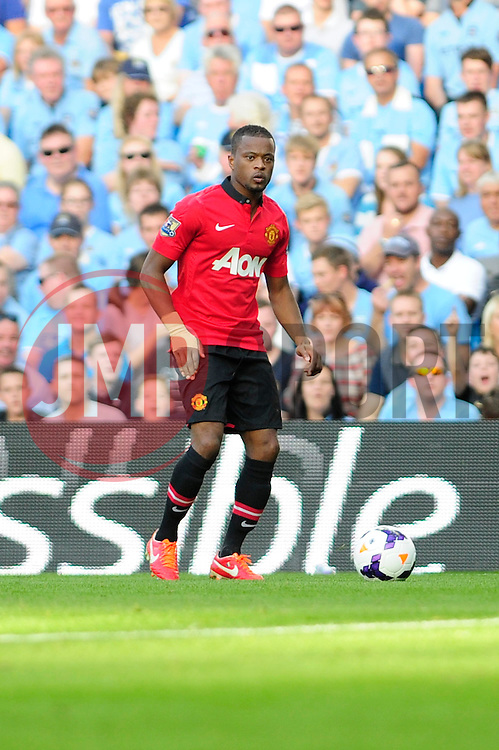 Manchester United's Patrice Evra - Photo mandatory by-line: Dougie Allward/JMP - Tel: Mobile: 07966 386802 22/09/2013 - SPORT - FOOTBALL - City of Manchester Stadium - Manchester - Manchester City V Manchester United - Barclays Premier League