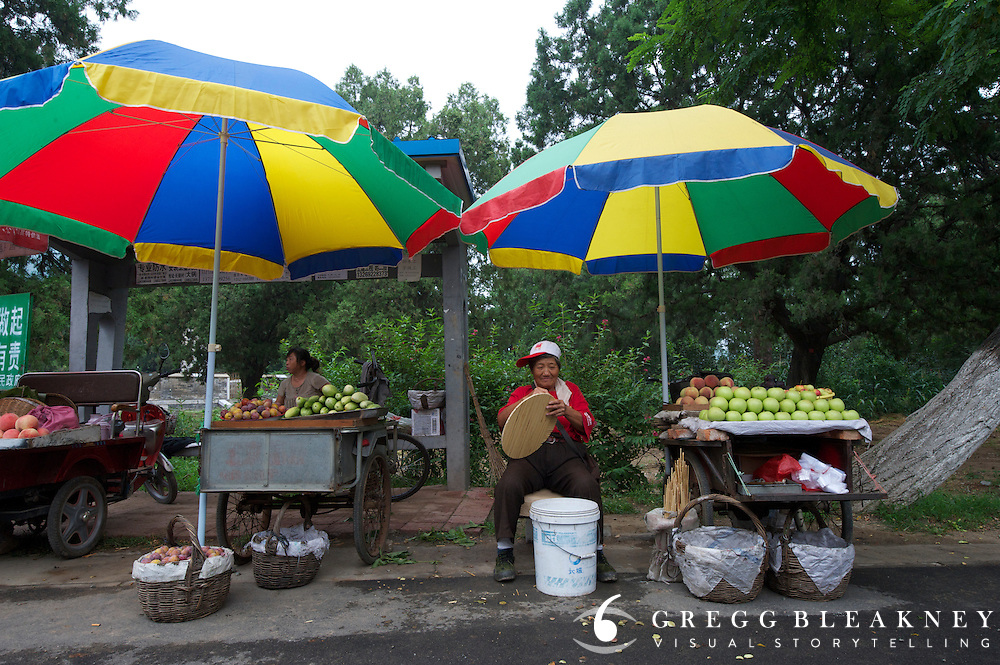 A fruit vendor along the Tour of Beijing's queen stage (this region is known for fruit production) - Stage Three, 162km, Shangyu island to Yongning Town via Thirteen Ming Tombs Reservoir - 2011 Tour of Beijing Scouting Photos