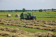 bailing round bails of native grass hay