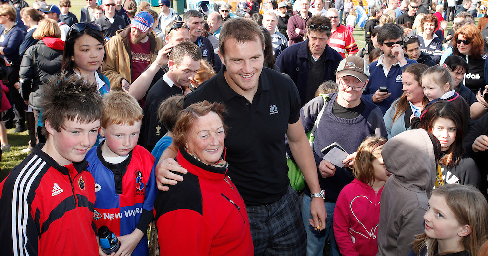Captain Alastair Kellock, centre from the Scottish World Cup Rugby team having photos taken with fans, during the teams visit to the Fanzone, North Hagley Park, Christchurch, New Zealand, Saturday, September 17, 2011.  Credit:SNPA / Pam Johnson
