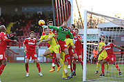 Crawley's Goalkeeper Matt Harrold punches clear during the Sky Bet League 1 match between Crawley Town and Milton Keynes Dons at Broadfield Stadium, Crawley, England on 10 January 2015. Photo by Phil Duncan.