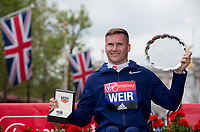 David Weir GBR smiles with his salver following his win in the Elite Wheelchair Men's RaceThe Virgin Money London Marathon, 23rd April 2017.<br /> <br /> Photo: Jed Leicester for Virgin Money London Marathon<br /> <br /> For further information: media@londonmarathonevents.co.uk