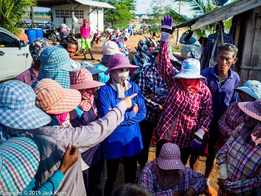 20 FEBRUARY 2019 - BAN LAEM, PHETCHABURI, THAILAND: Salt workers meet for their assignments on one of the first days of the 2019 salt harvest in Ban Laem, Thailand. Ban Laem's salt fields are expanding because salt harvesters in Samut Sakhon and Samut Songkhram,  which are closer to Bangkok, are moving to Ban Laem as their land is turned into industrial parks.     PHOTO BY JACK KURTZ