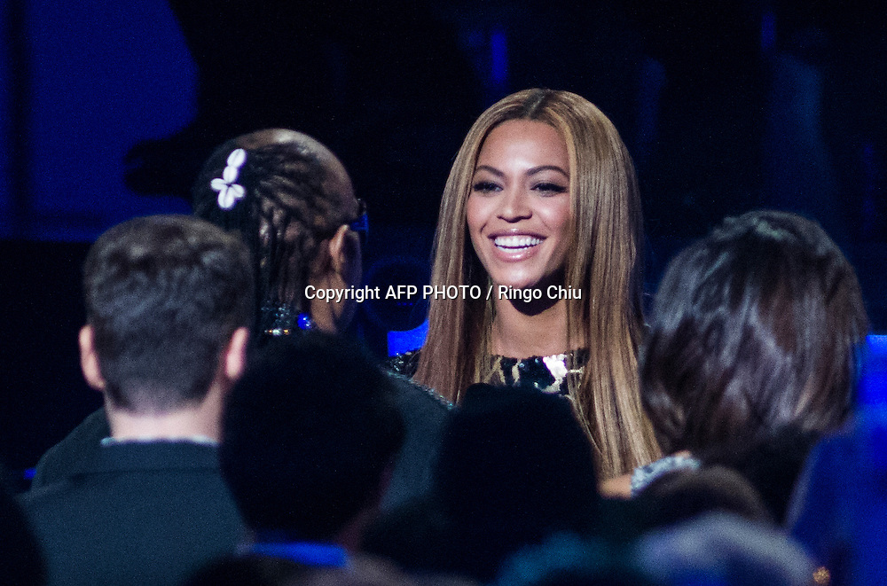 Beyonce, right, greets honoree Stevie Wonder in the audience before her performance during a concert, Stevie Wonder: Songs In The Key Of Life - An All-Star GRAMMY Salute, at Nokia Theatre L.A. Live on February 10, 2015 in Los Angeles, California. AFP PHOTO / Ringo Chiu