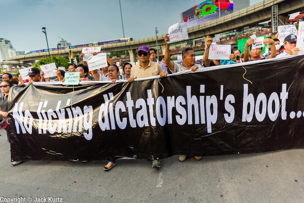 26 MAY 2014 - BANGKOK, THAILAND:  People march around Victory Monument during a pro-democracy rally in Bangkok. About two thousand people protested against the coup in Bangkok. It was the third straight day of large pro-democracy rallies in the Thai capital as the army continued to tighten its grip on Thai life.  PHOTO BY JACK KURTZ