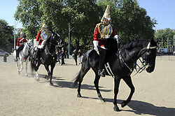 © licenced to London News Pictures.London,UK..27/04/2011.Royal Wedding Preparations.Captain Edward Olver (front rider) .making up the Queen's life guard before the Royal Wedding. .Please see Special Instructions..Picture credit should read Grant Falvey/London News Pictures