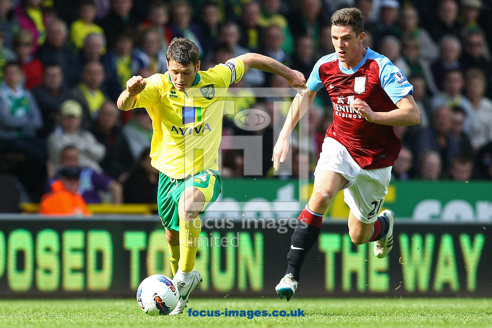 Picture by Paul Chesterton/Focus Images Ltd.  07904 640267.13/05/12.Ciaran Clark of Aston Villa and Wes Hoolahan of Norwich in action during the Barclays Premier League match at Carrow Road Stadium, Norwich.
