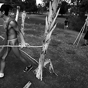 "The a youth wearing a Hawaiian outfit called a ""malo"" pulls a spear from a target has he competes in 'o'o ihe (spear throwing) as part of the Makahiki season celebration, which was the ancient Hawaiian New Year festival, in honor of the god Lono of the Hawaiian religion. In the Hawaiian language, the word Makahiki means ""year"" as well as the change from harvest time to the beginning of the agricultural season."