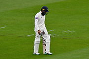Hashim Amla of Hampshire looks dejected as he walks back to the pavilion after losing his wicket to Josh Tongue of Worcestershire during the Specsavers County Champ Div 1 match between Hampshire County Cricket Club and Worcestershire County Cricket Club at the Ageas Bowl, Southampton, United Kingdom on 13 April 2018. Picture by Graham Hunt.