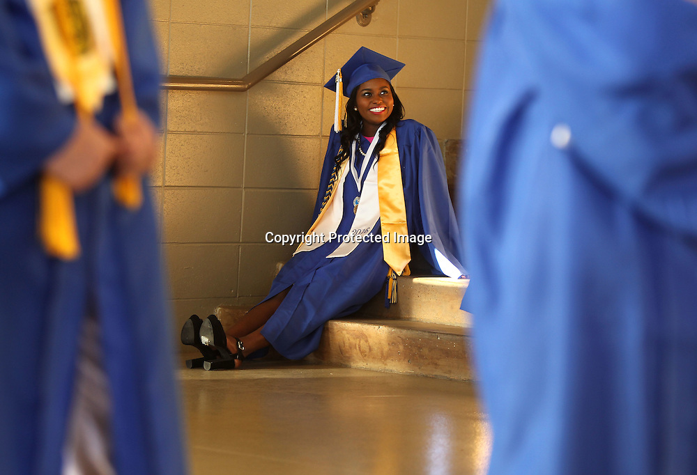 Adam Robison | BUT AT PHOTOS.DJOURNAL.COM<br /> Saltillo graduating Senior Alexis Harris sits on the steps at the BancorpSouth Arena as she waits with her class before entering the Arena for graduation Saturday night in Tueplo.
