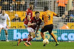 Adam Matthews of Bristol City challenges Jeremy Helan of Wolverhampton Wanderers - Mandatory byline: Dougie Allward/JMP - 08/03/2016 - FOOTBALL - Molineux Stadium - Wolverhampton, England - Wolves v Bristol City - Sky Bet Championship