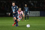 Billy Waters and Callum McFadzean   during the EFL Sky Bet League 2 match between Cheltenham Town and Bury at LCI Rail Stadium, Cheltenham, England on 5 March 2019.