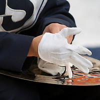 A member of the Penn State Blue Band puts on his gloves before taking the field prior to the Nittany Lions game against the Illinois Fighting Illini on November 2, 2013 at Beaver Stadium in University Park, Pennsylvania.