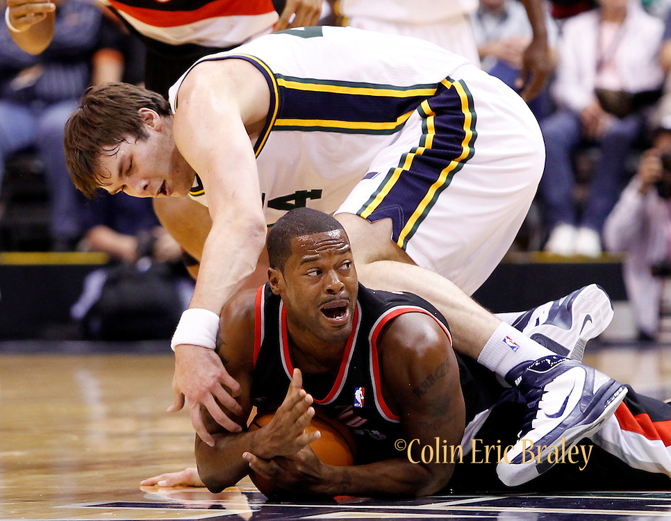 Portland Trail Blazers forward Marcus Gamby, bottom, calls a time out after grabbing a loose ball as Utah Jazz center Kyrylo Fesenko of the Ukraine, top, defends during the first half of their NBA preseason basketball game in Salt Lake City, Thursday, Oct. 7, 2010. (AP Photo/Colin E Braley)
