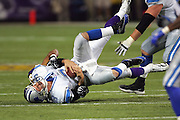 MINNEAPOLIS - NOVEMBER 21:  Kevin Williams #93 of the Minnesota Vikings gets one of his three quarterback sacks on Joey Harrington #3 of the Detroit Lions at the Hubert H. Humphrey Metrodome on November 21, 2004 in Minneapolis, Minnesota. The Vikings defeated the Lions 22-19. ©Paul Anthony Spinelli  *** Local Caption *** Kevin Williams;Joey Harrington