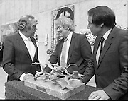 The G.P.A.awards for Emerging Artists..(Guinness Peat Aviation).1984..23.09.1984..09.23.1984..23rd September 1984..The award ceremony was held at The Royal Hibernian Academy of Arts,Gallagher Gallery,Ely Place,Dublin..Image of Mr Tony Ryan, GPA Director, Mr Seamus Heaney recipient of the award for Outstanding Individual Contribution to the Arts and The Minister for Arts and Culture,Mr Ted Nealon TD discussing the merits of a piece of sculpture...