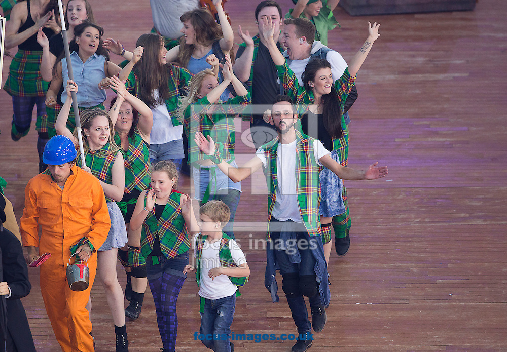 Dancers perform during the Glasgow 2014 Commonwealth Games Opening Ceremony at Celtic Park, Glasgow<br /> Picture by Paul Terry/Focus Images Ltd +44 7545 642257<br /> 23/07/2014