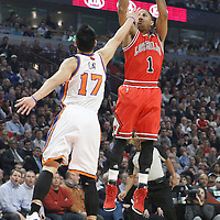 12 March 2012: Chicago Bulls point guard Derrick Rose (1) takes a jumpshot over New York Knicks point guard Jeremy Lin (17) during the first half of New York Knicks vs Chicago Bulls, at the United Center, Chicago, Illinois, USA.