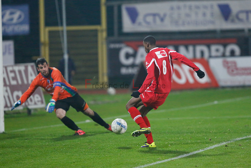 20141129 - La Louvière, Belgium : KV Turnhout's  Said BAKARI (#8) shoot toward the goal of UR La Louvière Centre's GK & Captain Fabian CREMERS (#1) during the 3rd division game betwen La Louvière and Turnhout on 29/11/2014 in La Louvière (Stade du Tivoli)